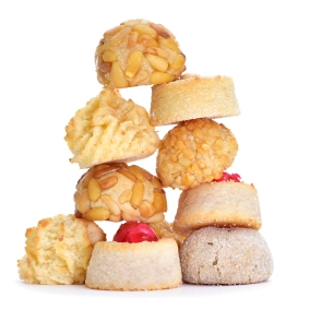 a pile of different panellets, typical pastries of Catalonia, Spain, eaten in All Saints Day, on a white background
