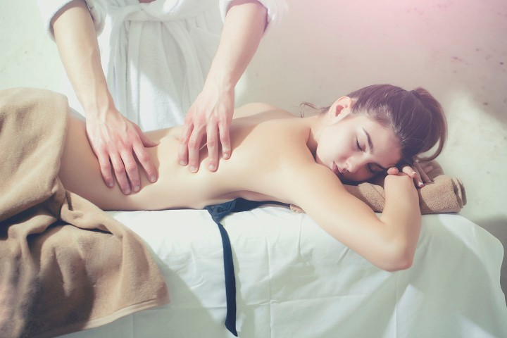 sexy woman on spa salon massage with male hands
